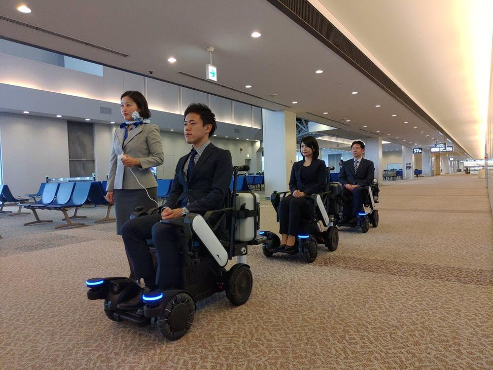 photo: Testing the electric wheelchair at Narita Airport