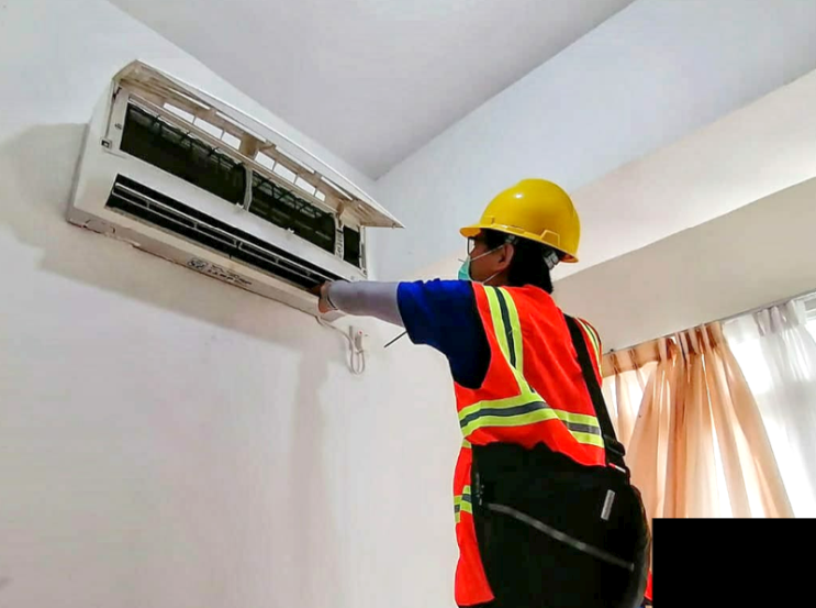 Photo: Air conditioners being refurbished in Wisma Atlet Kemayoran