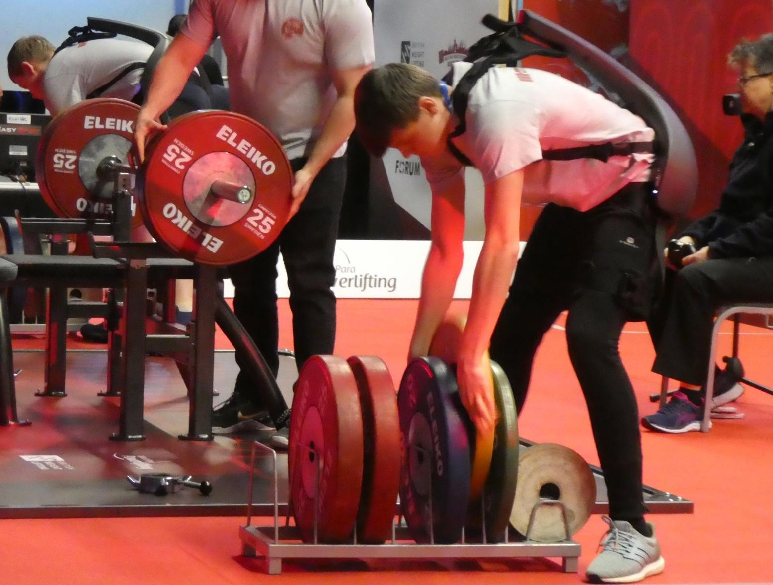 Photo: The spotter/loader personnel using Panasonic's Power Assist Suit at the Manchester 2020 Para Powerlifting World Cup