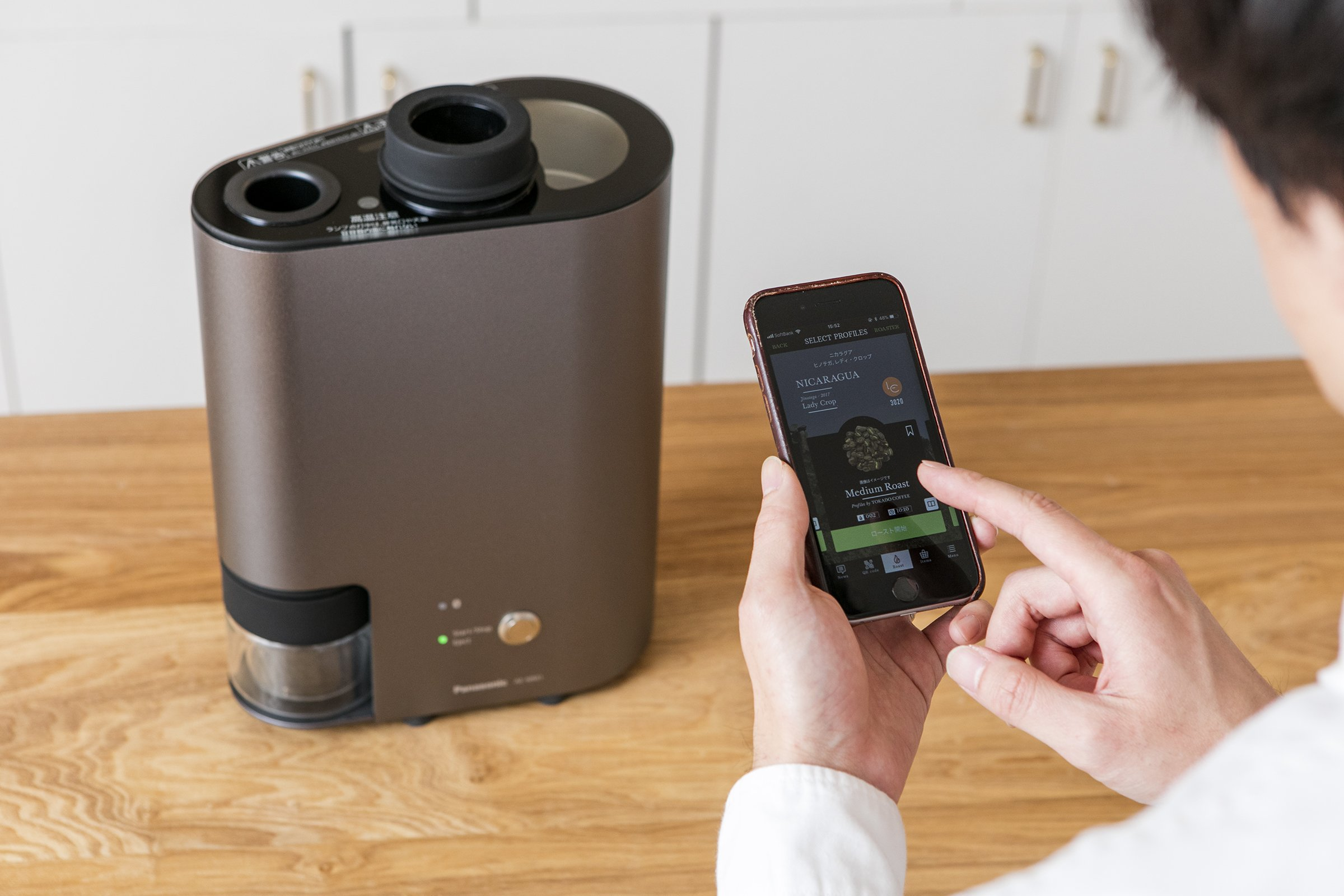 Photo: Person controlling The Roast using the app.