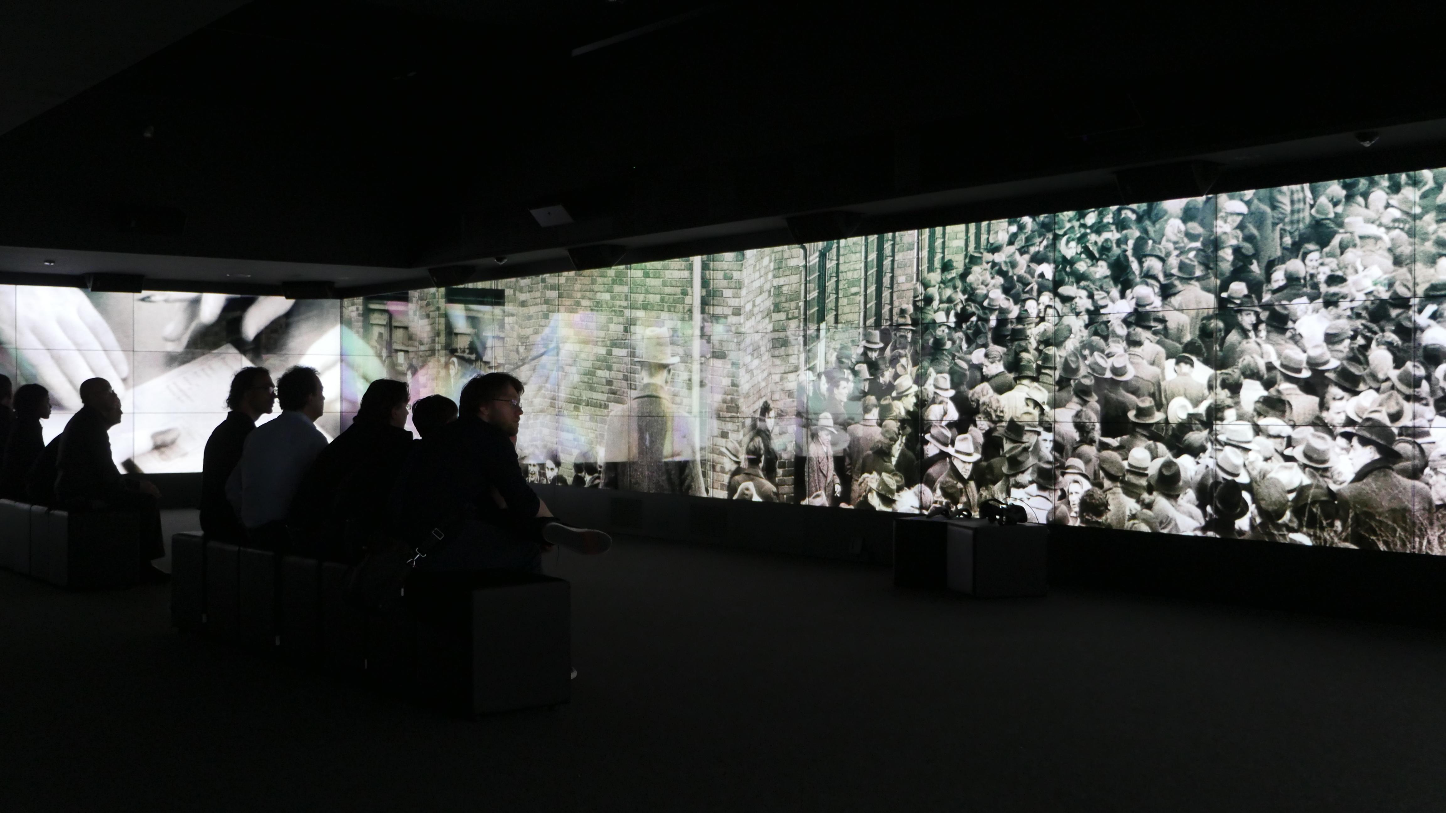 photo: videowall screens in the Brandenburg Gate Museum using 87 screens of Panasonic's