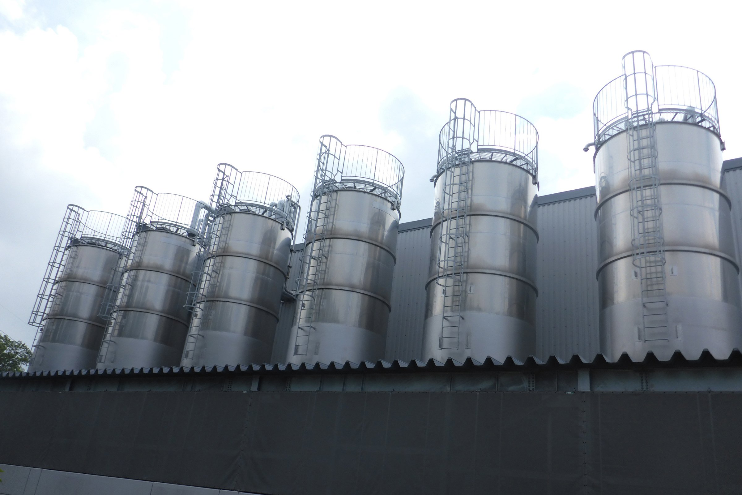 Photo: Six tanks for storing wastewater from the factory.