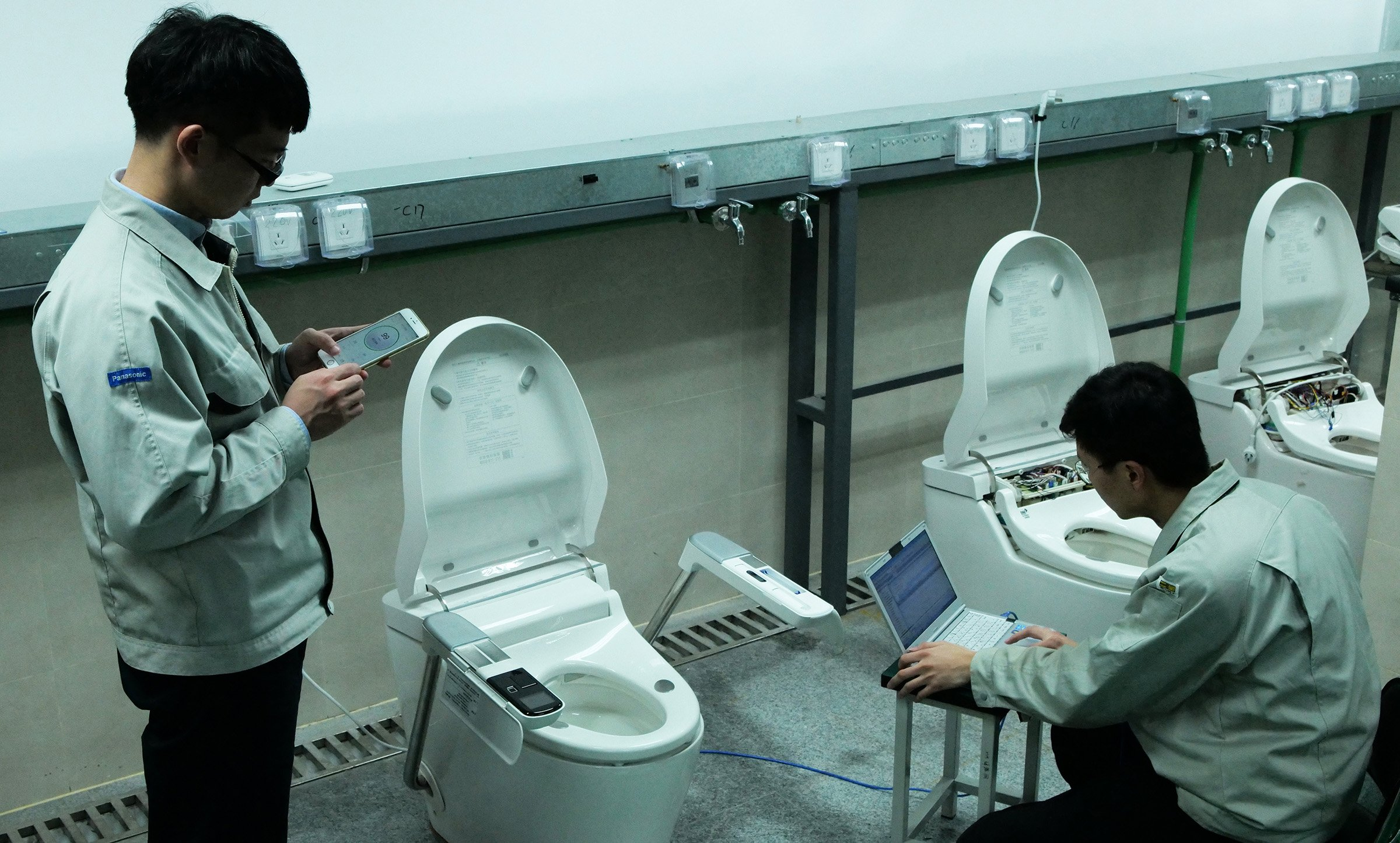 Photo: Engineers testing the connectivity with smartphones.