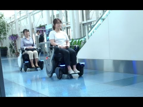 Robotic Electric Wheelchair WHILL NEXT & LinkRay Signage - Hospitality Solutions at Haneda Airport